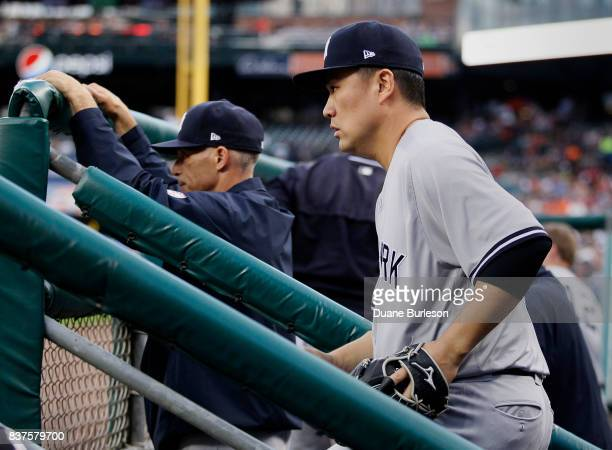 Pitcher Masahiro Tanaka of the New York Yankees heads for the field to pitch against the Detroit Tigers during the second inning at Comerica Park on...
