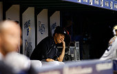 Pitcher Masahiro Tanaka of the New York Yankees looks on from the dugout during the third inning of a game against the Tampa Bay Rays on May 11 2015...