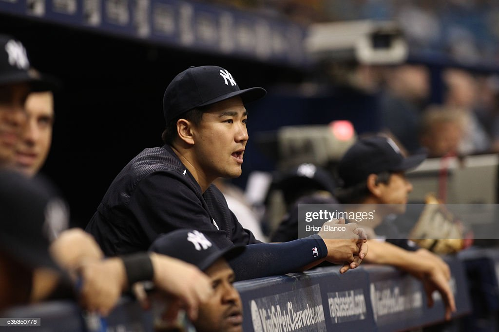 Pitcher <a gi-track='captionPersonalityLinkClicked' href=/galleries/search?phrase=Masahiro+Tanaka&family=editorial&specificpeople=5492836 ng-click='$event.stopPropagation()'>Masahiro Tanaka</a> #19 of the New York Yankees looks on from the dugout during the first inning of a game against the Tampa Bay Rays on May 29, 2016 at Tropicana Field in St. Petersburg, Florida.