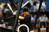 Pitcher Masahiro Tanaka of the New York Yankees takes batting practice before the start of a game against the Tampa Bay Rays on September 15 2015 at...