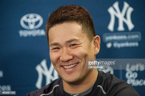 Pitcher Masahiro Tanaka of the New York Yankees talks with the media during spring training media availability at George M Steinbrenner Field on...