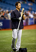 Pitcher Masahiro Tanaka of the New York Yankees waits to take batting practice before the start of a game against the Tampa Bay Rays on September 15...