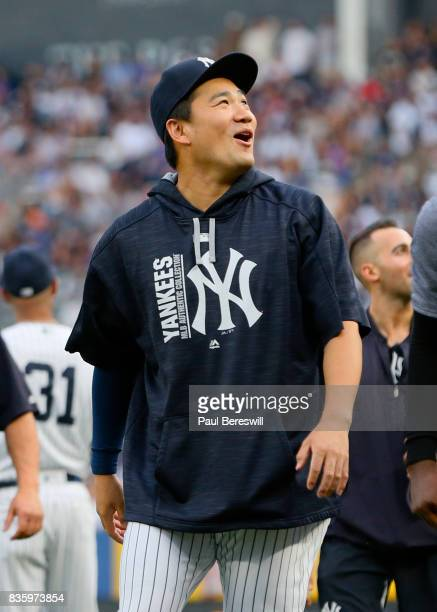 Pitcher Masahiro Tanaka of the New York Yankees walks in from the bullpen before the start of an MLB baseball game against the New York Mets on...