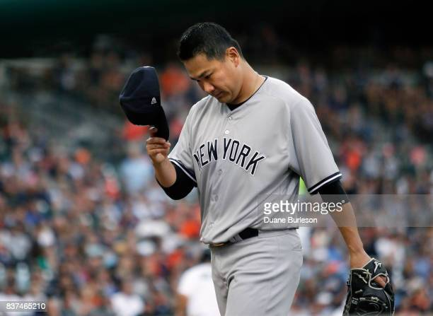 Pitcher Masahiro Tanaka of the New York Yankees walks to the dugout after pitching against the Detroit Tigers during the first inning at Comerica...