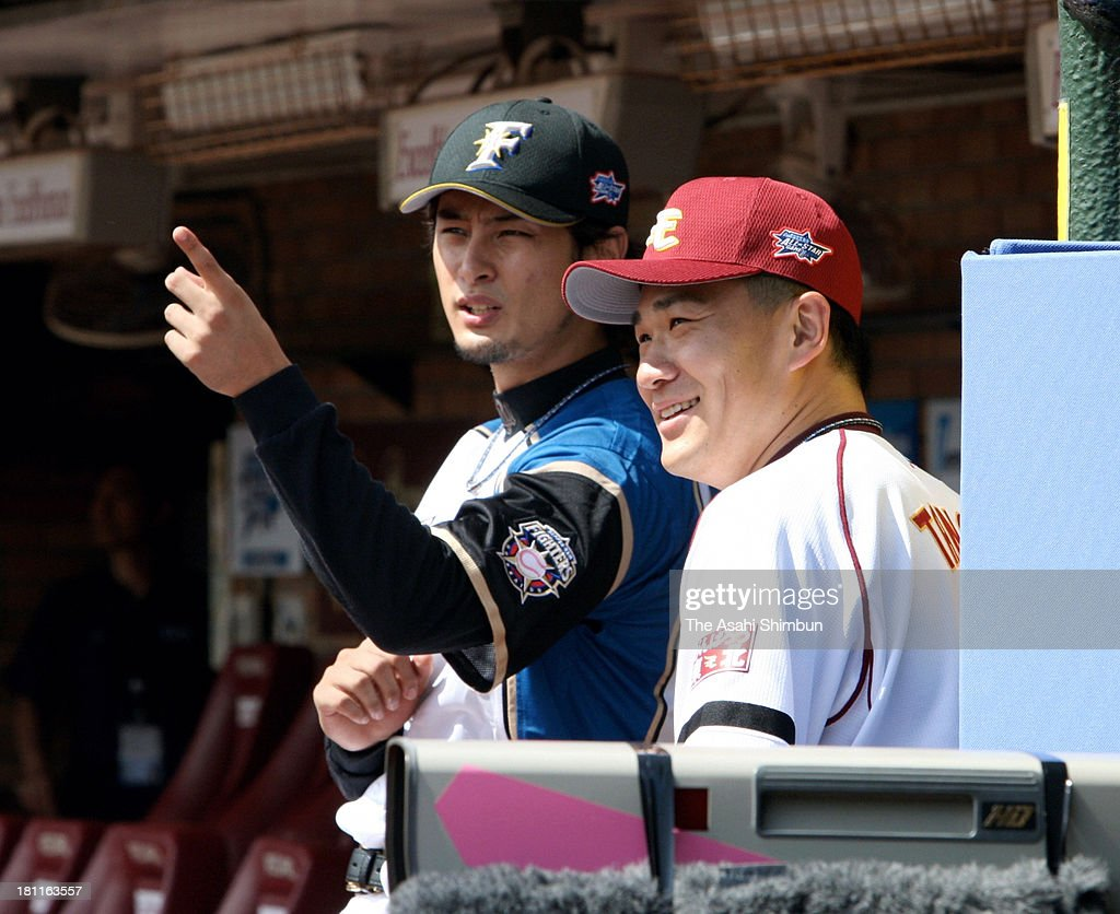 Pitcher <a gi-track='captionPersonalityLinkClicked' href=/galleries/search?phrase=Masahiro+Tanaka&family=editorial&specificpeople=5492836 ng-click='$event.stopPropagation()'>Masahiro Tanaka</a> (R) of Tohoku Rakuten Golden Eagles and <a gi-track='captionPersonalityLinkClicked' href=/galleries/search?phrase=Yu+Darvish&family=editorial&specificpeople=4018539 ng-click='$event.stopPropagation()'>Yu Darvish</a> (L) of Hokkaido Nipponham Fighters talk in the dugout during the All Star Game at Kleenex Stadium Miyagi on July 24, 2011 in Sendai, Miyagi, Japan.