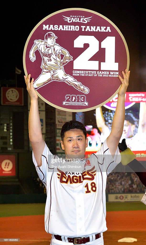 Pitcher <a gi-track='captionPersonalityLinkClicked' href=/galleries/search?phrase=Masahiro+Tanaka&family=editorial&specificpeople=5492836 ng-click='$event.stopPropagation()'>Masahiro Tanaka</a> of Tohoku Rakuten Golden Eagles poses after the win against Orix Buffaloes at Kleenex Stadium Miyagi on September 13, 2013 in Sendai, Miyagi, Japan. Tanaka achived 21 consecutive game win from the start of 2013 season.