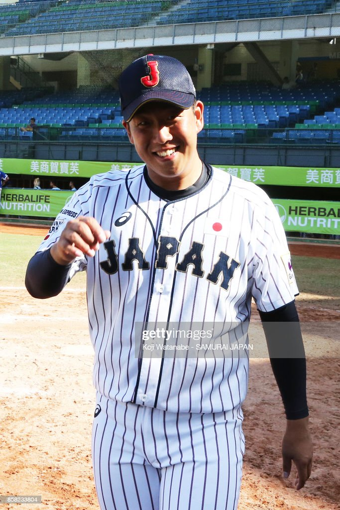 Pitcher Masaki Tanigawa celebrates their 3-0 victory during the 28th Asian Baseball Championship Super Round match between Japan and South Korea at Hsing-Chuang Stadium on October 6, 2017 in New Taipei City, Taiwan.