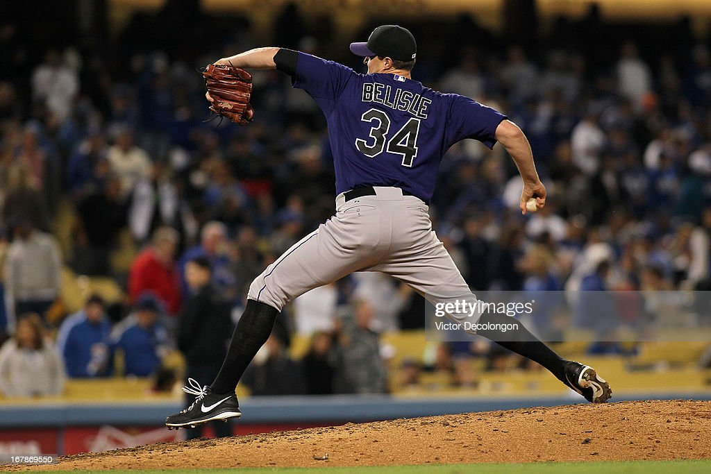 Pitcher Matt Belisle #34 of the Colorado Rockies pitches in the seventh inning against the Los Angeles Dodgers in relief of Edgmer Escalona #61 (not in photo) during the MLB game at Dodger Stadium on April 30, 2013 in Los Angeles, California. The Dodgers defeated the Rockies 6-2.