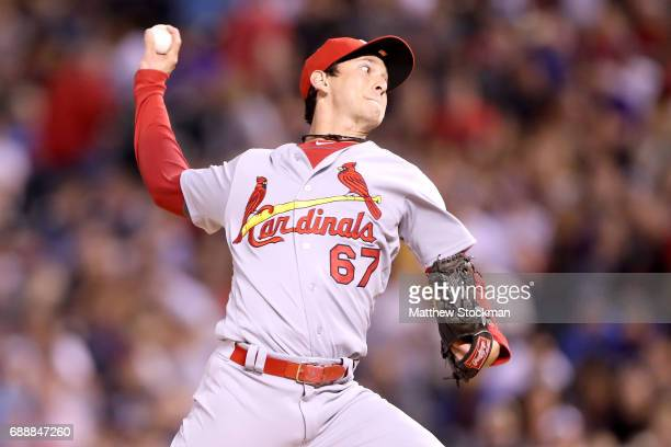 Pitcher Matt Bowman of the St Louis Cardinals throws in the eighth inning against the Colorado Rockies at Coors Field on May 26 2017 in Denver...
