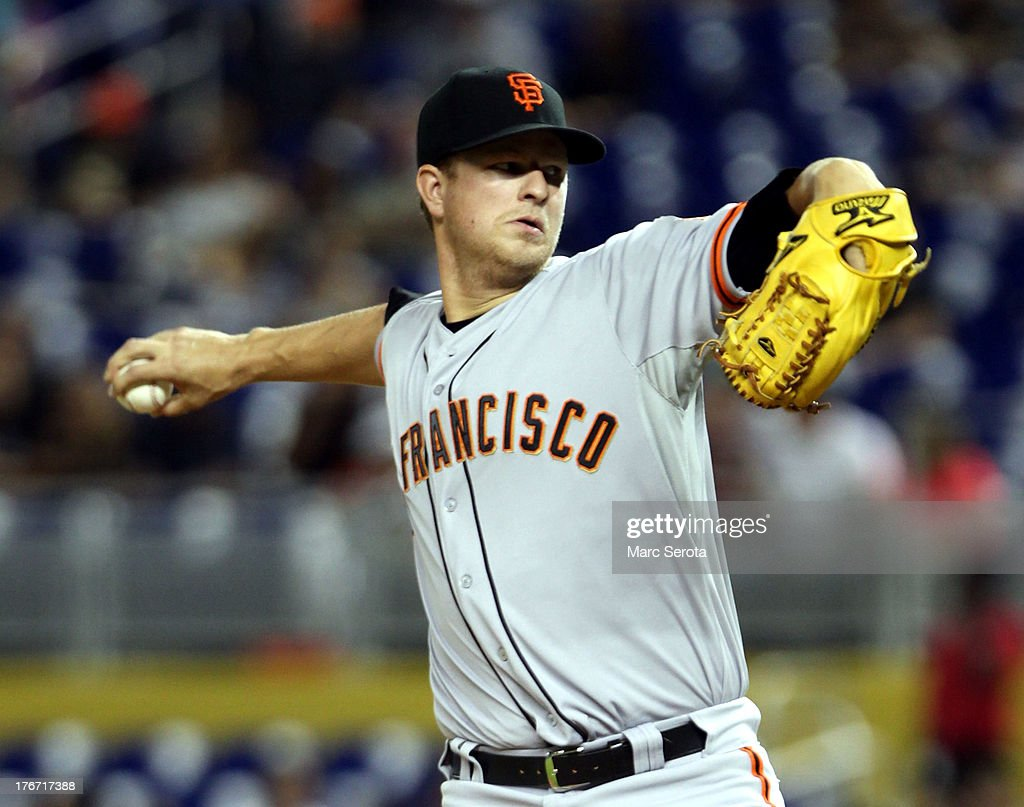 Pitcher <a gi-track='captionPersonalityLinkClicked' href=/galleries/search?phrase=Matt+Cain&family=editorial&specificpeople=534602 ng-click='$event.stopPropagation()'>Matt Cain</a> #18 of the San Francisco Giants throws against the Miami Marlins at Marlins Park on August 17, 2013 in Miami, Florida. The Giants defeated the Marlins 6-4.