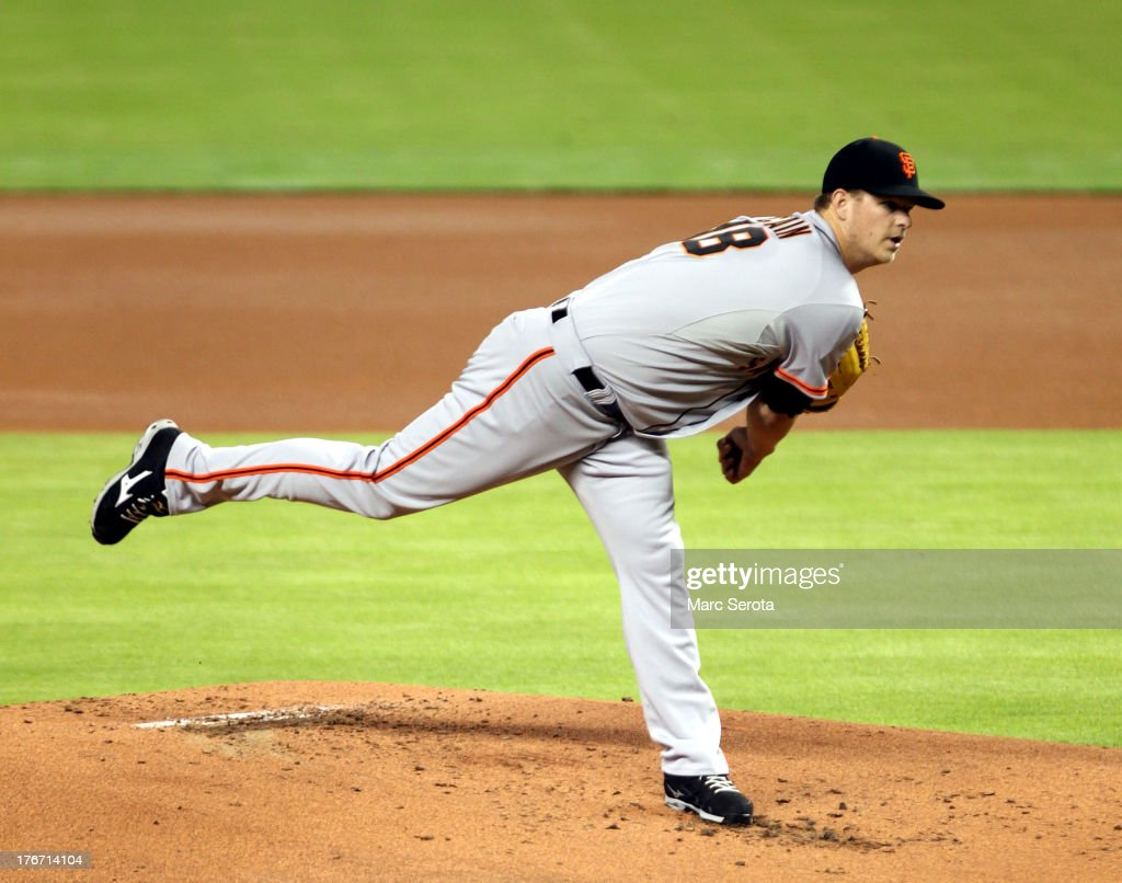 Pitcher <a gi-track='captionPersonalityLinkClicked' href=/galleries/search?phrase=Matt+Cain&family=editorial&specificpeople=534602 ng-click='$event.stopPropagation()'>Matt Cain</a> #18 of the San Francisco Giants throws against the Miami Marlins during the first inning at Marlins Park on August 17, 2013 in Miami, Florida.