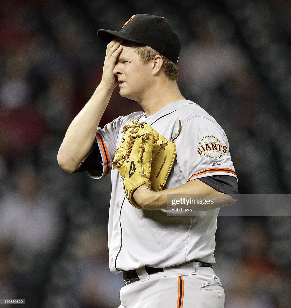 Pitcher <a gi-track='captionPersonalityLinkClicked' href=/galleries/search?phrase=Matt+Cain&family=editorial&specificpeople=534602 ng-click='$event.stopPropagation()'>Matt Cain</a> #18 of the San Francisco Giants wipes his face after giving up a home run to Fernando Martinez #21 of the Houston Astros in trhe fifth inning at Minute Maid Park on August 28, 2012 in Houston, Texas.