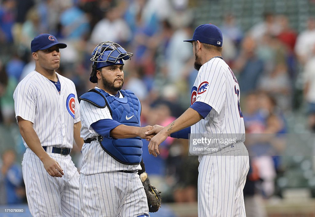 Pitcher Matt Garza #22 of the Chicago Cubs shakes hands with catcher Dioner Navarro #30 after the Cubs defeated the Houston Astros 3-1 at Wrigley Field on June 21, 2013 in Chicago, Illinois.