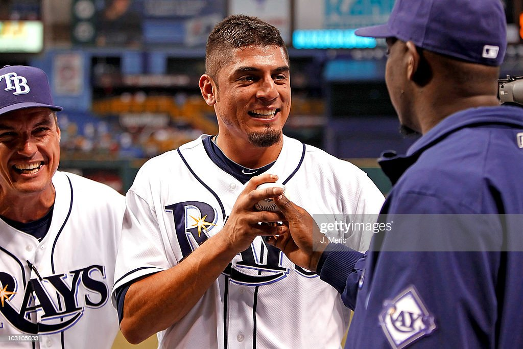 Pitcher Matt Garza #22 of the Tampa Bay Rays gets a game ball from pitcher <a gi-track='captionPersonalityLinkClicked' href=/galleries/search?phrase=Rafael+Soriano&family=editorial&specificpeople=587892 ng-click='$event.stopPropagation()'>Rafael Soriano</a> #29 as pitching coach <a gi-track='captionPersonalityLinkClicked' href=/galleries/search?phrase=Jim+Hickey&family=editorial&specificpeople=643232 ng-click='$event.stopPropagation()'>Jim Hickey</a> (L) looks on after the no hitter against the Detroit Tigers at Tropicana Field on July 26, 2010 in St. Petersburg, Florida. Tampa Bay beat Detroit 5-0.