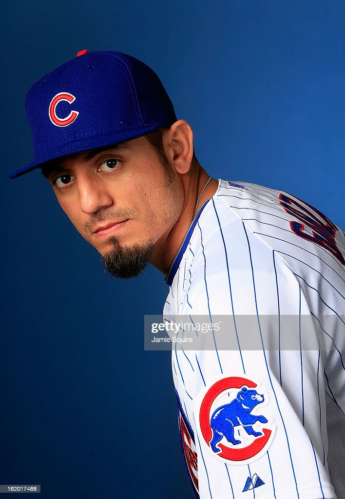 Pitcher <a gi-track='captionPersonalityLinkClicked' href=/galleries/search?phrase=Matt+Garza&family=editorial&specificpeople=835829 ng-click='$event.stopPropagation()'>Matt Garza</a> #22 poses during Chicago Cubs photo day on February 18, 2013 at HoHoKam Park in Mesa, Arizona.