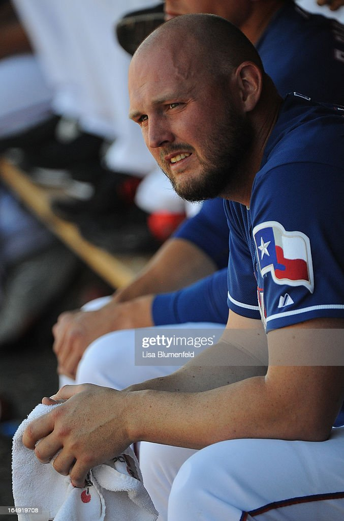 Pitcher <a gi-track='captionPersonalityLinkClicked' href=/galleries/search?phrase=Matt+Harrison&family=editorial&specificpeople=4171692 ng-click='$event.stopPropagation()'>Matt Harrison</a> #54 of the Texas Rangers sits in the dugout during the game against the Chicago White Sox at Surprise Stadium on March 26, 2013 in Surprise, Arizona.