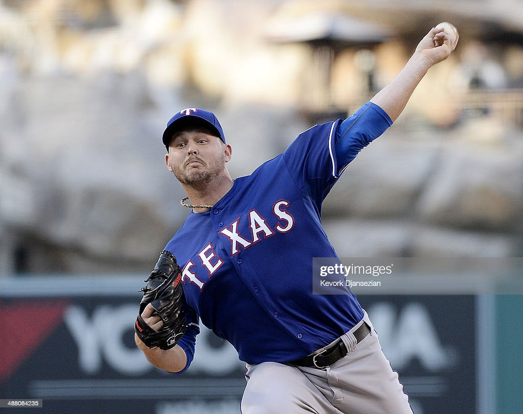 Pitcher <a gi-track='captionPersonalityLinkClicked' href=/galleries/search?phrase=Matt+Harrison&family=editorial&specificpeople=4171692 ng-click='$event.stopPropagation()'>Matt Harrison</a> #54 of the Texas Rangers throws against Los Angeles Angels of Anaheim in the first inning at Angel Stadium of Anaheim on May 3, 2014 in Anaheim, California.