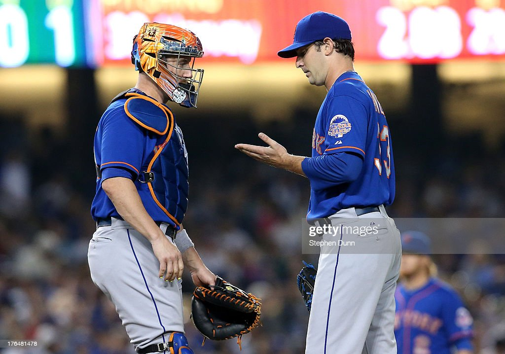 Pitcher Matt Harvey #33 and catcher <a gi-track='captionPersonalityLinkClicked' href=/galleries/search?phrase=John+Buck&family=editorial&specificpeople=213730 ng-click='$event.stopPropagation()'>John Buck</a> #44 of the New York Mets confer during the fifth inning against the Los Angeles Dodgers at Dodger Stadium on August 13, 2013 in Los Angeles, California.