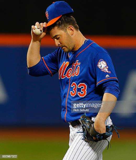Pitcher Matt Harvey of the New York Mets reacts after giving an RBI triple to Ben Revere of the Washington Nationals during the third inning of a...