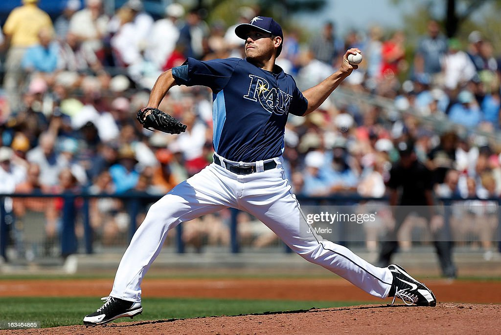 Pitcher <a gi-track='captionPersonalityLinkClicked' href=/galleries/search?phrase=Matt+Moore+-+Baseball+Player&family=editorial&specificpeople=15003307 ng-click='$event.stopPropagation()'>Matt Moore</a> #55 of the Tampa Bay Rays pitches against the Boston Red Sox during a Grapefruit League Spring Training Game at the Charlotte Sports Complex on March 10, 2013 in Port Charlotte, Florida.