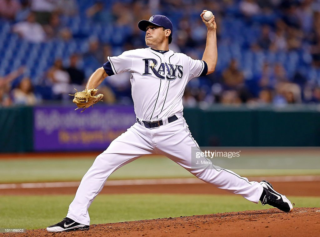 Pitcher <a gi-track='captionPersonalityLinkClicked' href=/galleries/search?phrase=Matt+Moore+-+Baseball+Player&family=editorial&specificpeople=15003307 ng-click='$event.stopPropagation()'>Matt Moore</a> #55 of the Tampa Bay Rays pitches against the Oakland Athletics during the game at Tropicana Field on August 24, 2012 in St. Petersburg, Florida.