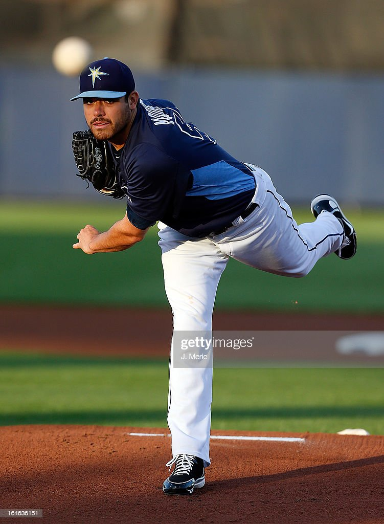 Pitcher <a gi-track='captionPersonalityLinkClicked' href=/galleries/search?phrase=Matt+Moore+-+Baseball+Player&family=editorial&specificpeople=15003307 ng-click='$event.stopPropagation()'>Matt Moore</a> #55 of the Tampa Bay Rays pitches against the Pittsburgh Pirates during a Grapefruit League Spring Training Game at the Charlotte Sports Complex on March 25, 2013 in Port Charlotte, Florida.