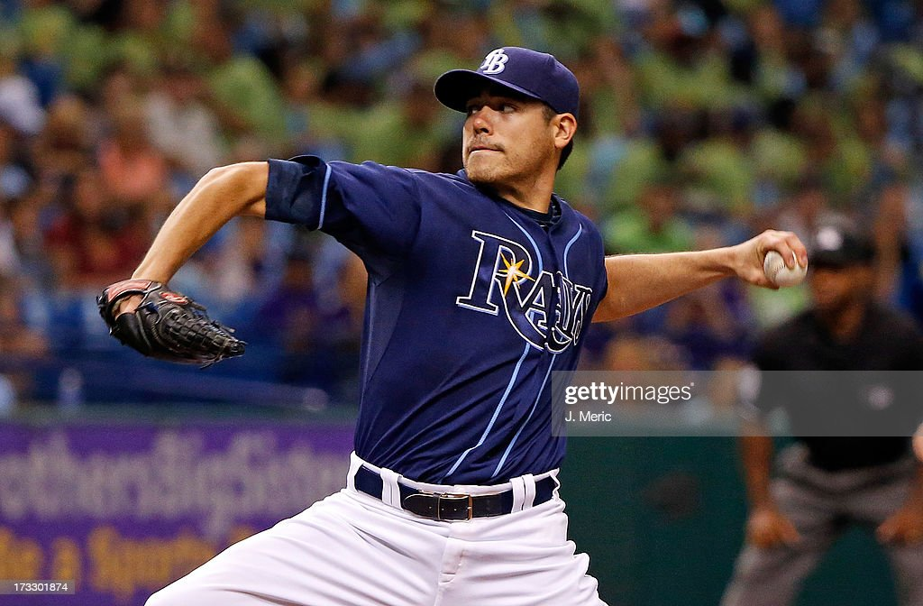 Pitcher <a gi-track='captionPersonalityLinkClicked' href=/galleries/search?phrase=Matt+Moore+-+Baseball+Player&family=editorial&specificpeople=15003307 ng-click='$event.stopPropagation()'>Matt Moore</a> #55 of the Tampa Bay Rays pitches against the Minnesota Twins during the game at Tropicana Field on July 11, 2013 in St. Petersburg, Florida.