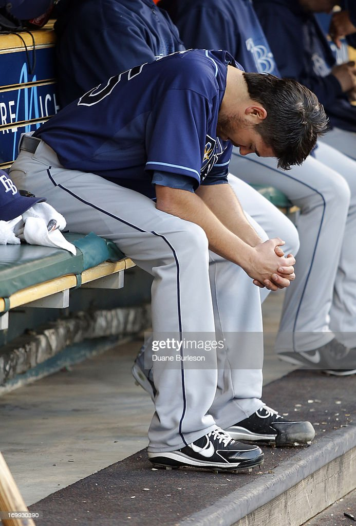 Pitcher <a gi-track='captionPersonalityLinkClicked' href=/galleries/search?phrase=Matt+Moore+-+Baseball+Player&family=editorial&specificpeople=15003307 ng-click='$event.stopPropagation()'>Matt Moore</a> #55 of the Tampa Bay Rays sits in the dugout after being pulled in the third inning of a baseball game against the Detroit Tigers at Comerica Park on June 4, 2013 in Detroit, Michigan. Moore gave up six runs on seven hits while walking six batters in the 10-1 loss.