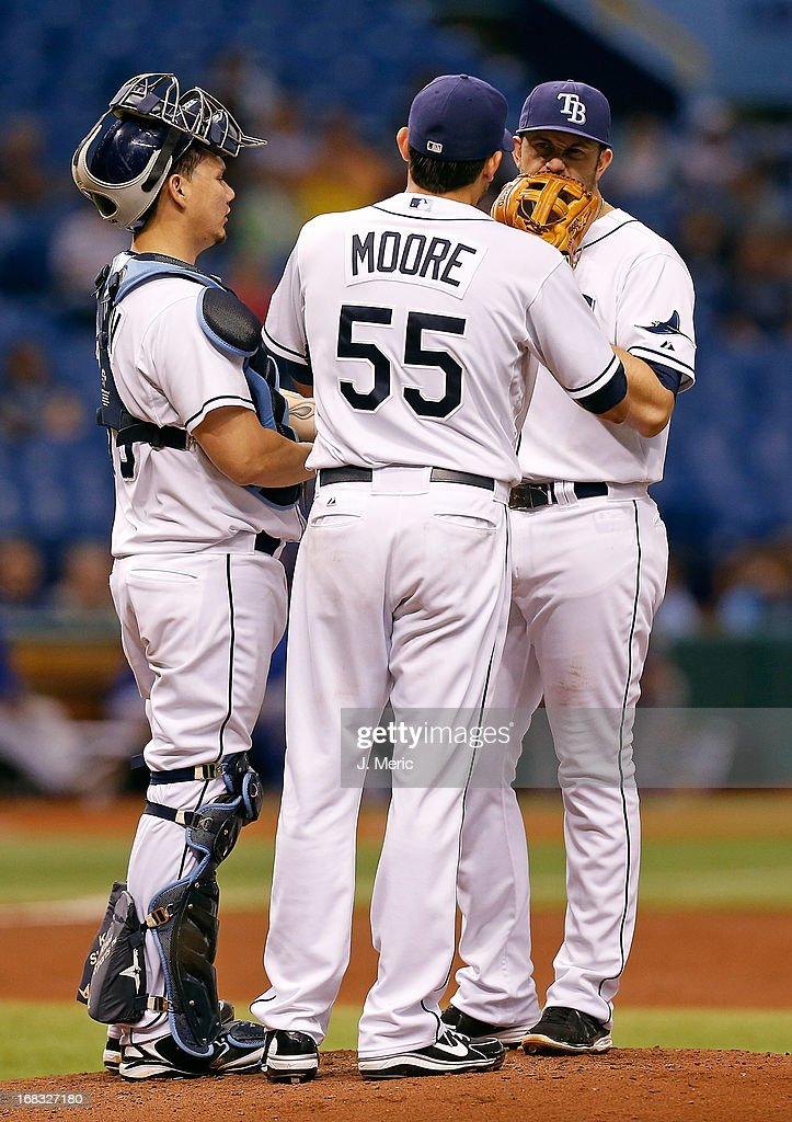 Pitcher <a gi-track='captionPersonalityLinkClicked' href=/galleries/search?phrase=Matt+Moore+-+Baseball+Player&family=editorial&specificpeople=15003307 ng-click='$event.stopPropagation()'>Matt Moore</a> #55 of the Tampa Bay Rays talks with catcher Jose Lobaton #59 and <a gi-track='captionPersonalityLinkClicked' href=/galleries/search?phrase=Evan+Longoria&family=editorial&specificpeople=2349329 ng-click='$event.stopPropagation()'>Evan Longoria</a> #3 during the game against the Toronto Blue Jays at Tropicana Field on May 8, 2013 in St. Petersburg, Florida.