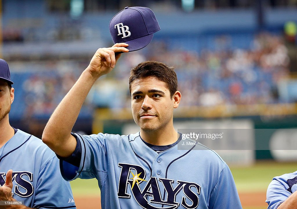 Pitcher <a gi-track='captionPersonalityLinkClicked' href=/galleries/search?phrase=Matt+Moore+-+Honkballer&family=editorial&specificpeople=15003307 ng-click='$event.stopPropagation()'>Matt Moore</a> #55 of the Tampa Bay Rays tips his hat as he receives his all star jersey just before the start of the game against the Houston Astros at Tropicana Field on July 14, 2013 in St. Petersburg, Florida.