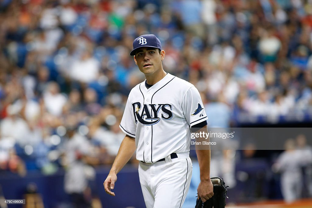 Pitcher <a gi-track='captionPersonalityLinkClicked' href=/galleries/search?phrase=Matt+Moore+-+Baseball+Player&family=editorial&specificpeople=15003307 ng-click='$event.stopPropagation()'>Matt Moore</a> #55 of the Tampa Bay Rays walks back to the dugout after being taken off the mound by manager Kevin Cash #16 during the fifth inning of a game against the Cleveland Indians on July 2, 2015 at Tropicana Field in St. Petersburg, Florida.