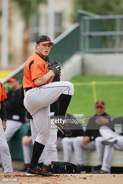 Pitcher Matt Riley of the Baltimore Orioles delivers a warm up pitch at Roger Dean Stadium on March 3 2005 in Jupiter Florida The Baltimore Orioles...
