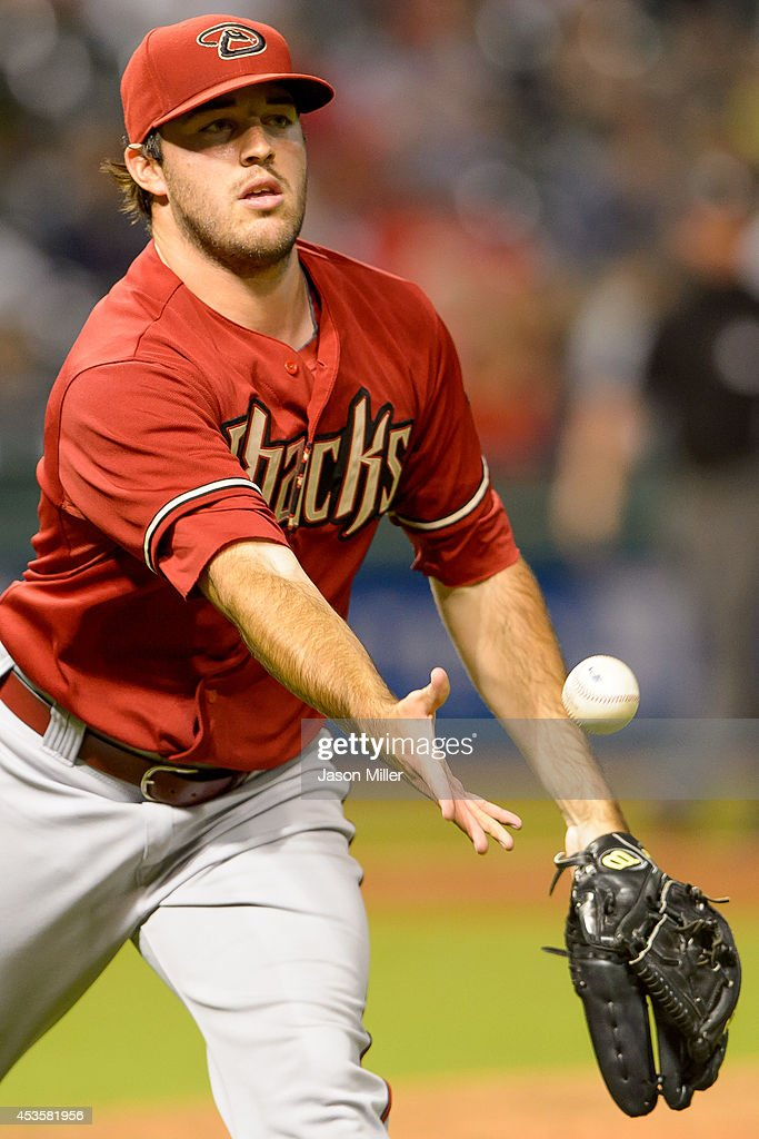Pitcher Matt Stites #37 of the Arizona Diamondbacks throws out Jose Ramirez #11 of the Cleveland Indians on a sacrifice bunt during the tenth inning at Progressive Field during the second game of a double header on August 13, 2014 in Cleveland, Ohio.