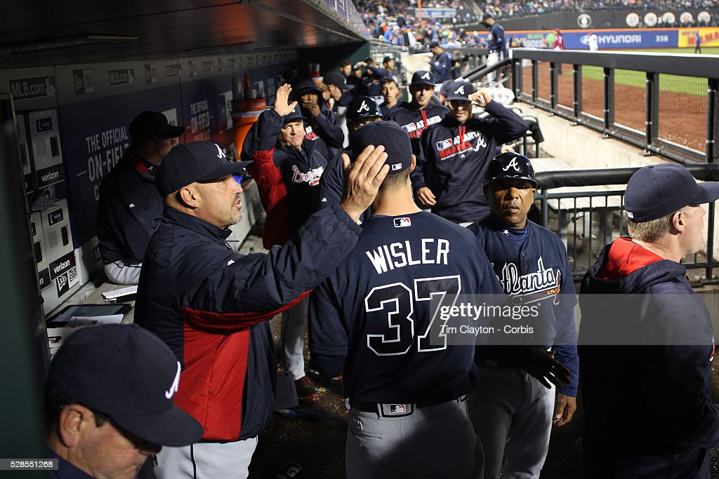 Pitcher Matt Wisler #37 of the Atlanta Braves is congratulated by manager Fredi Gonz��lez as he returns to the dugout after the eighth inning during the Atlanta Braves Vs New York Mets MLB regular season game at Citi Field on May 03, 2016 in New York City.