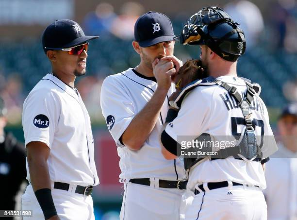 Pitcher Matthew Boyd of the Detroit Tigers center is visited by shortstop Dixon Machado of the Detroit Tigers and catcher Bryan Holaday of the...