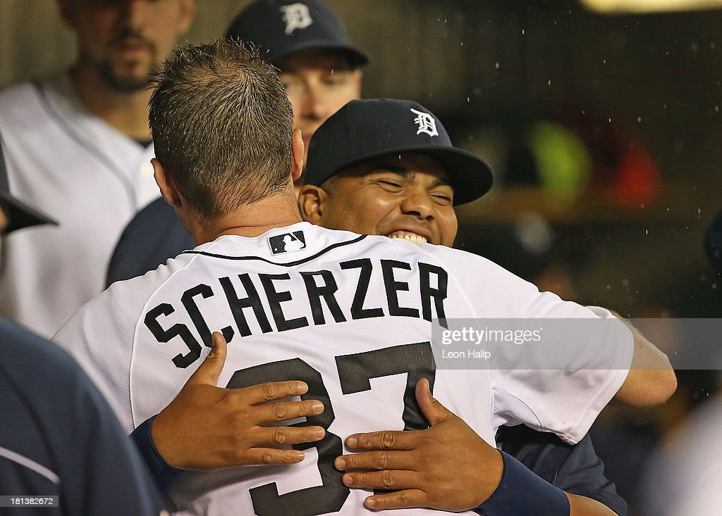Pitcher Max Scherzer #37 of the Detroit Tigers leaves the game at the end of the sixth inning and celebrates with teammate Brayan Pena #55 during the game against the Chicago White Sox at Comerica Park on September 20, 2013 in Detroit, Michigan.