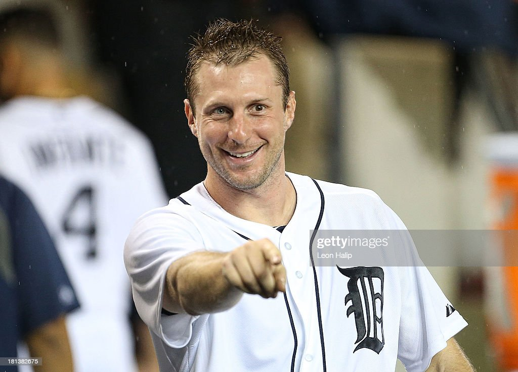 Pitcher <a gi-track='captionPersonalityLinkClicked' href=/galleries/search?phrase=Max+Scherzer&family=editorial&specificpeople=594071 ng-click='$event.stopPropagation()'>Max Scherzer</a> #37 of the Detroit Tigers leaves the game at the end of the sixth inning and celebrates with his teammates during the game against the Chicago White Sox at Comerica Park on September 20, 2013 in Detroit, Michigan.
