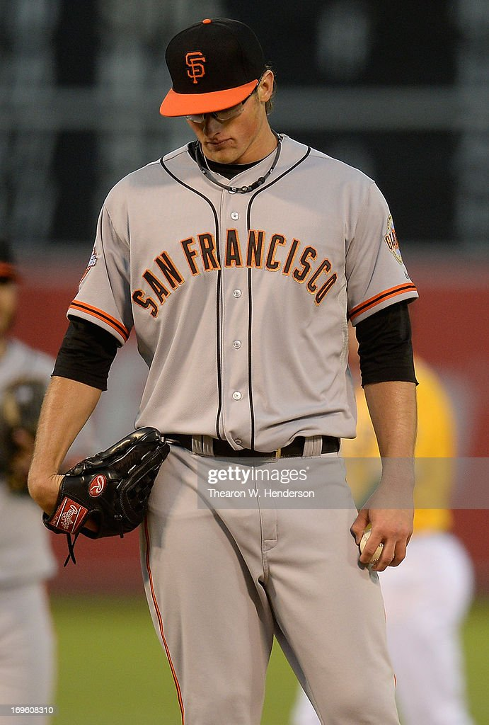 Pitcher Michael Kickham #59 of the San Francisco Giants stands on the mound and stears at the ground while waiting on manager Bruce Bochy to take him out of the game against the Oakland Athletics in the third inning at O.co Coliseum on May 28, 2013 in Oakland, California.