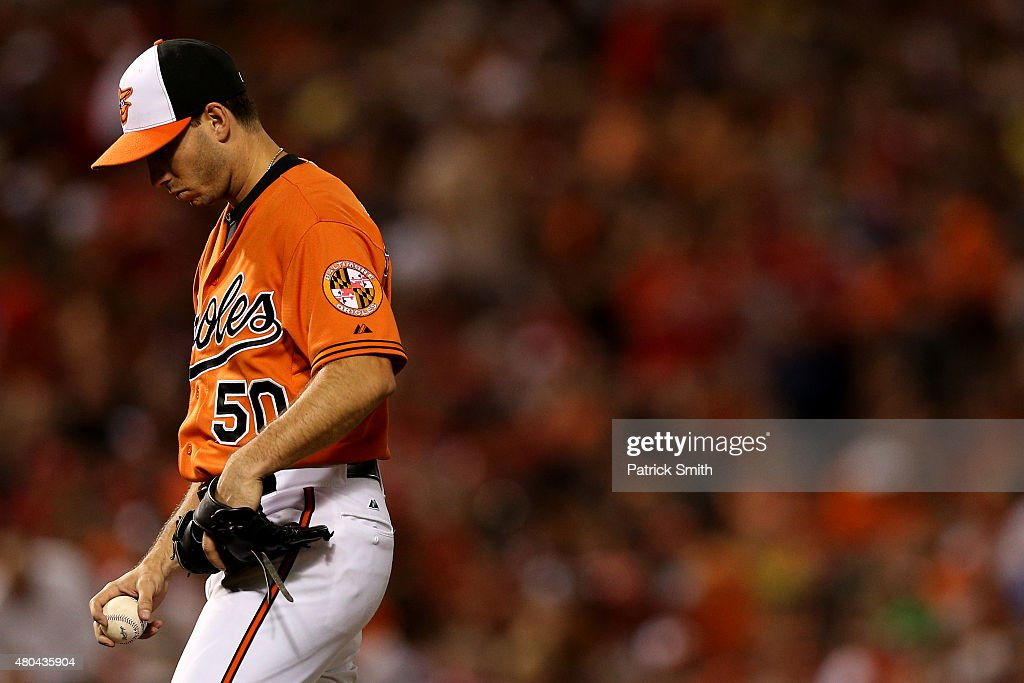 Pitcher Miguel Gonzalez #50 of the Baltimore Orioles reacts after giving up a three run home run to Danny Espinosa #8 of the Washington Nationals (not pictured) in the sixth inning at Oriole Park at Camden Yards on July 11, 2015 in Baltimore, Maryland. The Washington Nationals won, 7-4.