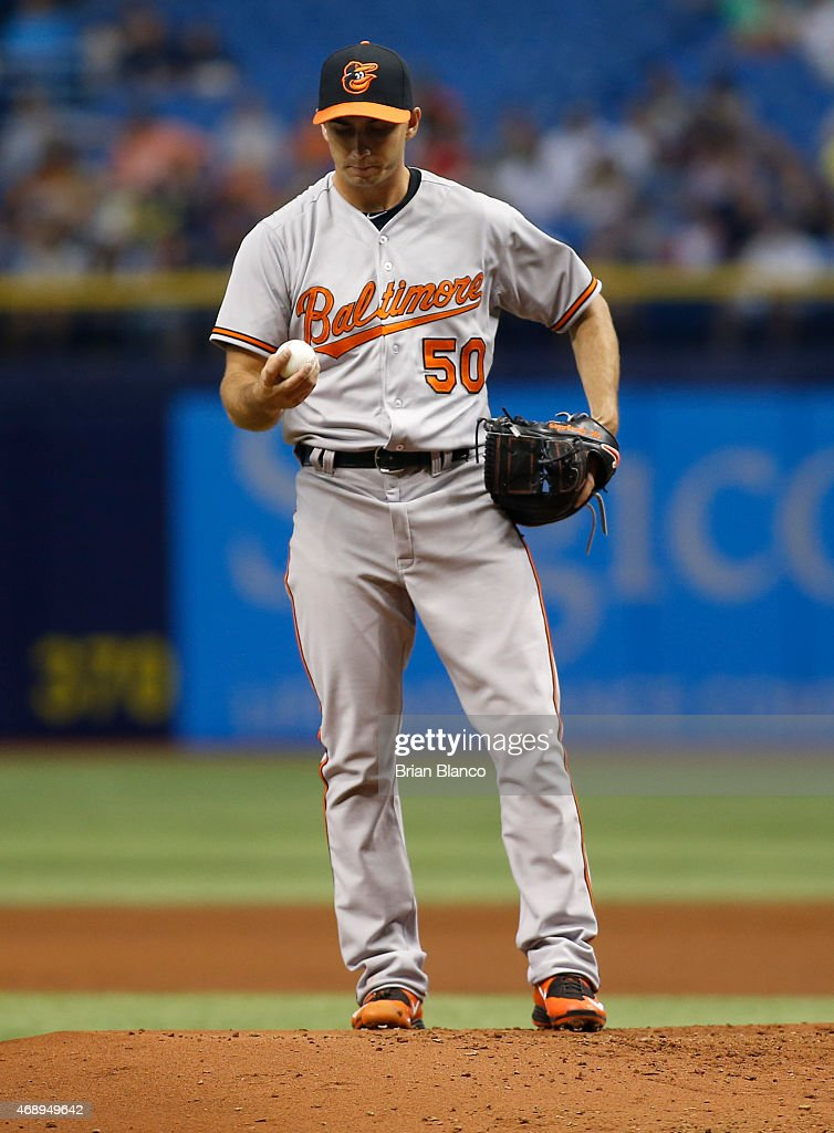 Pitcher Miguel Gonzalez #50 of the Baltimore Orioles reacts on the mound after walking Evan Longoria #3 of the Tampa Bay Rays to load the bases during the first inning of a game on April 8, 2015 at Tropicana Field in St. Petersburg, Florida.