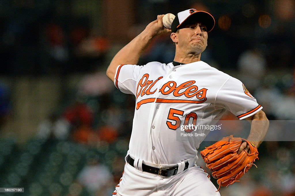 Pitcher Miguel Gonzalez #50 of the Baltimore Orioles works the first inning against the New York Yankees at Oriole Park at Camden Yards on September 10, 2013 in Baltimore, Maryland.