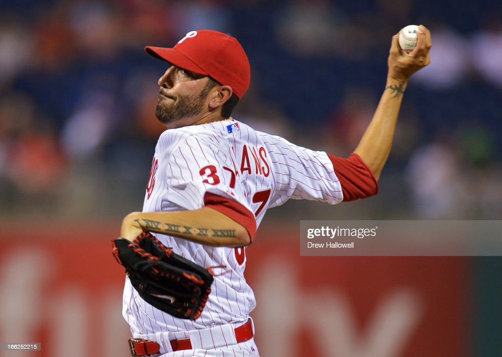 Pitcher Mike Adams #37 of the Philadelphia Phillies delivers a pitch in the eighth inning during the game against the New York Mets at Citizens Bank Park on April 10, 2013 in Philadelphia, Pennsylvania. The Phillies won 7-3.