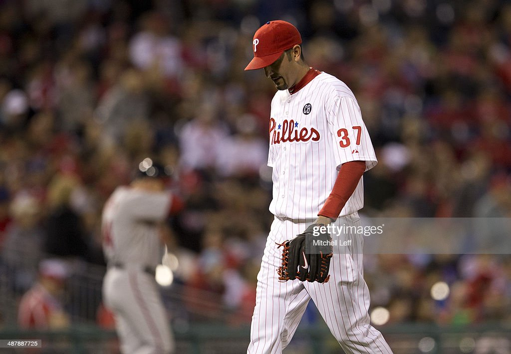 Pitcher Mike Adams #37 of the Philadelphia Phillies walks off the field in the eighth inning against the Washington Nationals on May 2, 2014 at Citizens Bank Park in Philadelphia, Pennsylvania.