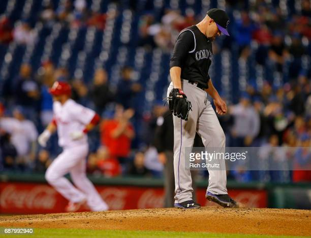 Pitcher Mike Dunn looks down and kicks the dirt as Michael Saunders of the Philadelphia Phillies rounds third base after he hit a tworun home run in...