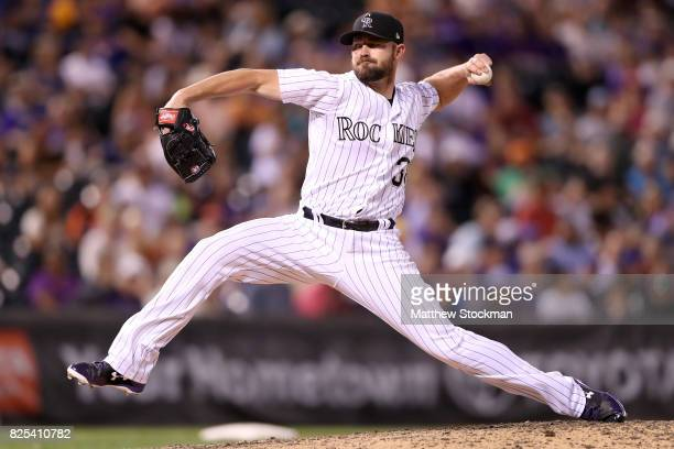 Pitcher Mike Dunn of the Colorado Rockies throws in the ninth inning against the New York Mets at Coors Field on August 1 2017 in Denver Colorado