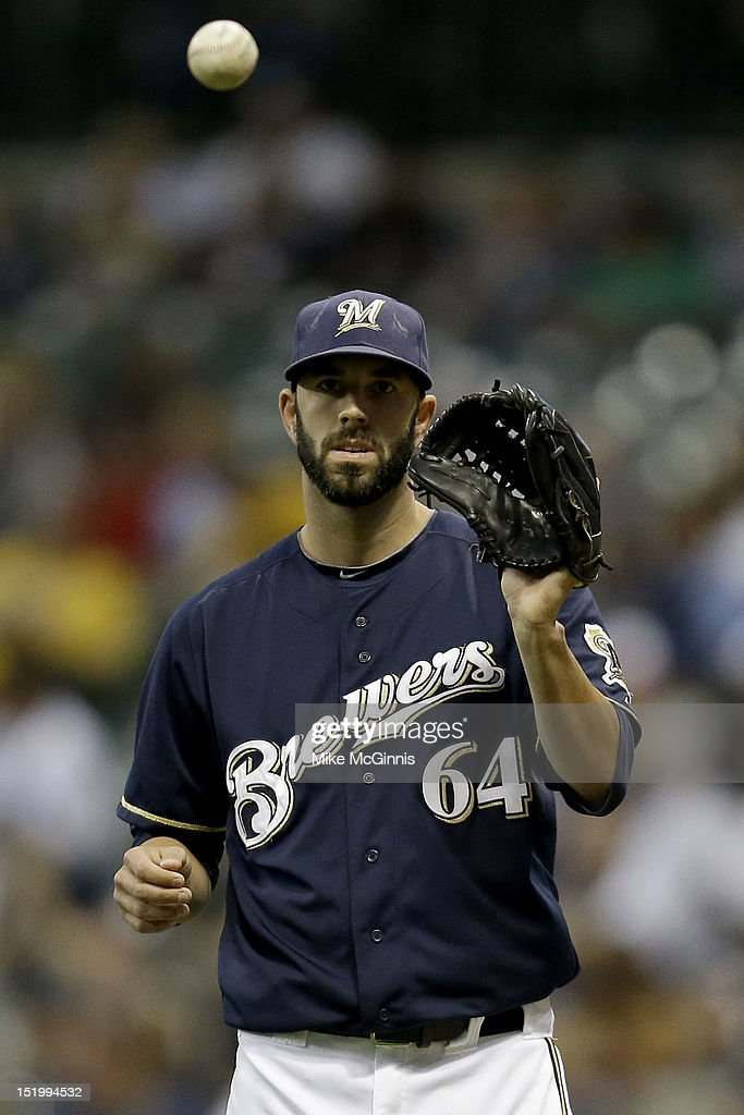 Pitcher Mike Fiers #64 of the Milwaukee Brewers takes the throw on the mound against the New York Mets during the game at Miller Park on September 14, 2012 in Milwaukee, Wisconsin.