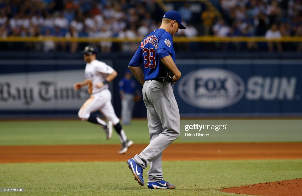 Pitcher Mike Montgomery #38 of the Chicago Cubs reacts after allowing a home run to Brad Miller #13 of the Tampa Bay Rays during the sixth inning of a game on September 19, 2017 at Tropicana Field in St. Petersburg, Florida.