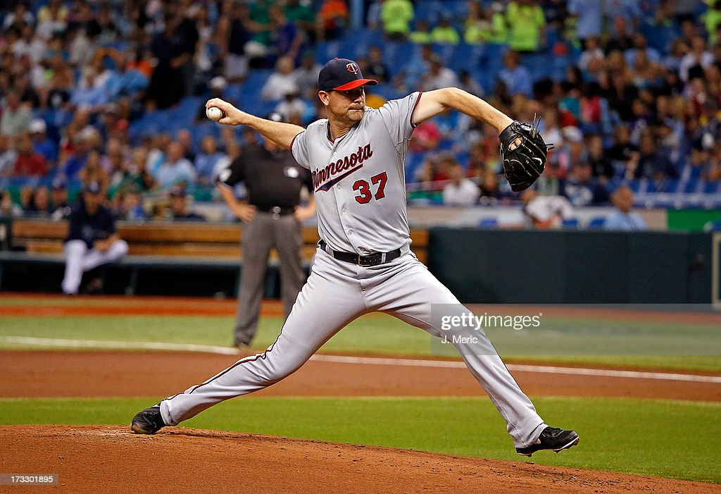 Pitcher <a gi-track='captionPersonalityLinkClicked' href=/galleries/search?phrase=Mike+Pelfrey&family=editorial&specificpeople=836534 ng-click='$event.stopPropagation()'>Mike Pelfrey</a> #37 of the Minnesota Twins pitches against the Tampa Bay Rays during the game at Tropicana Field on July 11, 2013 in St. Petersburg, Florida.