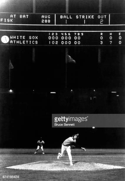 Pitcher Mike Warren of the Oakland Athletics throws the final pitch to Carlton Fisk of the Chicago White Sox to complete the nohitter during an MLB...