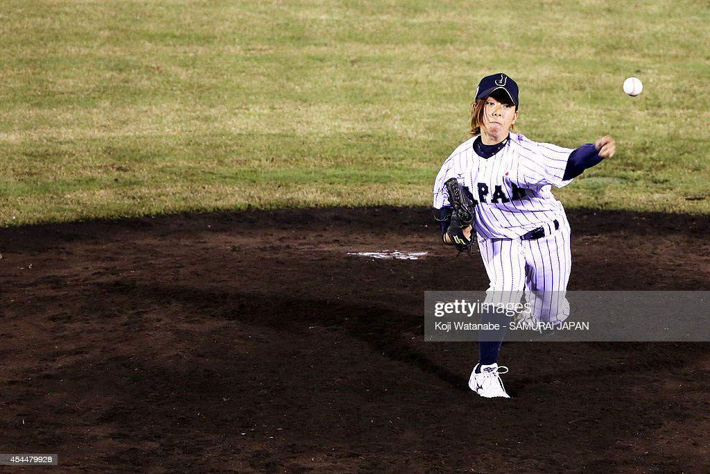 Pitcher <a gi-track='captionPersonalityLinkClicked' href=/galleries/search?phrase=Moemi+Yoshii&family=editorial&specificpeople=13536821 ng-click='$event.stopPropagation()'>Moemi Yoshii</a> #15 of Japan pitches during the IBAF Women's Baseball World Cup Group A game between Japan and Australia at Sun Marine Stadium on September 1, 2014 in Miyazaki, Japan.
